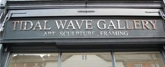 Tidal Wave Gallery stainless steel lettering