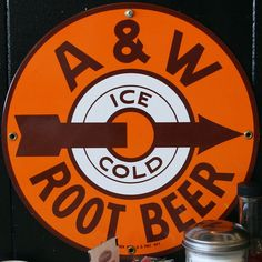Round sign that advertised the company's Ice Cold Root Beer. This variation has the arrow pointing through the middle. Four mounting holes one above '&', between root beer and two on either side of the arrow.
