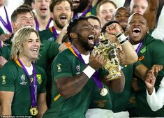 Kolisi beams with delight as he lifts the trophy with his team-mates in the centre of the . First World Cup, World Cup Final, Soccer Supplies, Dan Cole, Manu Tuilagi, South African Rugby, The Englishman, Victory Parade, Rugby World Cup