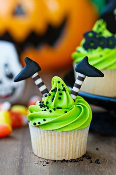 Halloween witch cupcakes with bright green frosting.