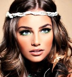 Gorgeous hair and makeup. Love her headband
