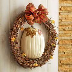 Greet your guests with this simple fall pumpkin wreath. Our craft pumpkins now come pre-cut in half, which makes this project one step simpler!