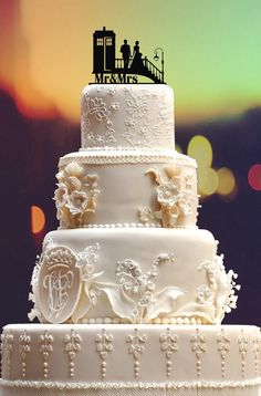 This is an awesome cake topper & following this pin will drop you at a British site with some great links for wedding cake toppers. BUT, I'm pinning this because of the fantabulous CAKE! Yeah, the cake topper can make or break s watching cake but this cake kicks sugary butt! Wow-wee! Gorgeous, just gorgeous. You may now resume you're regularly scheduled Pintrest.  ===  Awesome Wedding Cake Toppers for TV and Film Buffs - Dr Who cake topper