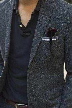 Black polo. Grey wool jacket. Pocket square.