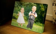 Personal photos of friends and family are printed onto canvas and stretched across wooden bars that require no frames to hang