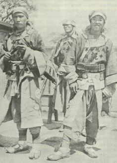 """A photo of young Boxers.  Ultimately, the Boxers converged on Beijing with the slogan """"support the Qing, exterminate the foreigners."""" They forced foreigners and Chinese Christians to seek refuge in the Legation Quarter. In response to reports of armed foreign landings and demands, the initially hesitant Empress Dowager Cixi, urged by the conservatives of the Imperial Court, supported the Boxers and on June 21 authorized war on foreign powers."""