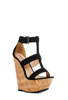 Strut into summer in this stunning sky-high wedge. Features rectangular cutout detail on straps and a real cork wrap. Adjustable ankle strap with buckle. Black Wedge Sandals, Platform Wedge Sandals, Platform High Heels, Black High Heels, Wedge Boots, Bootie Boots, Wedge Heels, Strap Sandals, Girls Shoes
