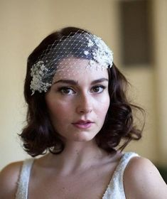 bride with short hair and a veil headpiece with floral and rhinestone details