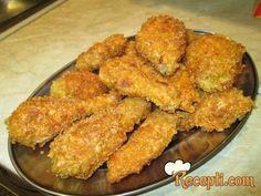 Recept za Piletina u kornfleksu. Za spremanje ovog jela neophodno je pripremiti pile, jaja, kurkumu, brašno, kornifleks, začin, ulje.