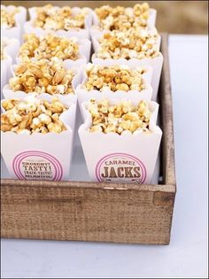 Carnival inspired food for a festive party or reception. Scallop-edged paper bags of popcorn with custom printable labels.