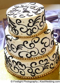 A black and white cake with gold pearls from Megin and Dan's Merry Pink and Purple Wedding