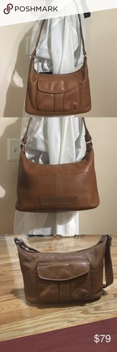 """Fossil hobo brown leather bag AND wallet Quality Soft leather – excellent craftsmanship FOSSIL zipper pull Exterior flap pocket with FOSSIL silky lining  Strap – approximate 12"""" drop to top of handbag Flat bottom – 10"""" x 4.5 Center height – 7"""" Interior – one zipper pocket, 2 open pockets on side, FOSSIL silky lining Interior tag – Genuine Leather, Made in China, sticker on back of tag with #ZB8016 FOSSIL labels on inside and outside of bag Great, Medium size perfect condition, comes with…"""