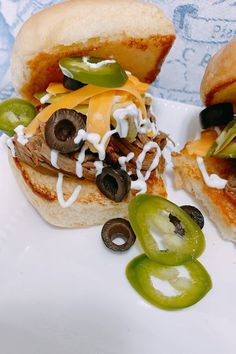 "Taco Shredded Beef Sliders | ""Assorted toppings like sliced avocado, shredded cheese, crema Mexicana, black olives, and jalapeño elevate this shredded beef to a perfect slider suitable for the big game day."" #footballrecipes #gamedayrecipes #tailgatingrecipes #superbowlrecipes #superbowlparty #superbowlpartyideas Mini Sliders, Beef Sliders, Shredded Beef, Olives, Avocado, Slider Buns, Tailgating Recipes, Burger Buns, Football Food"