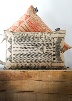 pillows with ancient language print
