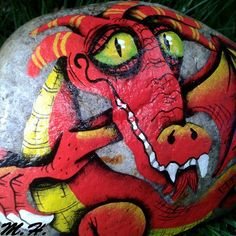 Tons of ideas for dragon rocks and a tutorial     http://www.pinterest.com/ninulka5/pebbles-and-stones-dragon/