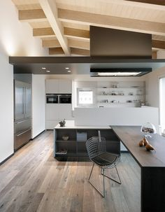 Unique arrangement for the island and seating! Attic Apartment by BRANDO concept Home Decor Kitchen, Kitchen Interior, Home Kitchens, Kitchen Design, Hall Interior, Attic Apartment, Apartment Design, Luxury Home Decor, Luxury Homes