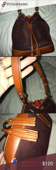 Barely used VELVET dooney and bourke bucket purse Gorgeous burgundy velvet purse with handcrafted leather! No scuffs of scratches! Authentic. Comes from a smoke/pet free home! Perfect for an everyday dramatic statement! 🌵 Dooney & Bourke Bags Shoulder Bags