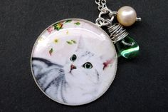 Gray Cat Necklace. Kitten Pendant Necklace with Green Teardrop and Fresh Water Pearl. Handmade Jewelry. by StumblingOnSainthood from Stumbling On Sainthood. Find it now at http://ift.tt/1RNNb7P!