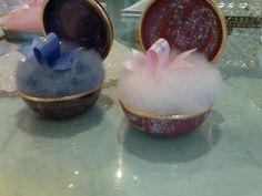 Caron powder puffs in porcelain jars