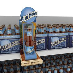 Lanzamiento Blue Moon SPMK - has little mirror behind bottle to look like you can see through rather than block some of product on shelf - reveals more of the bottle outside of cartons