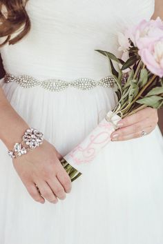 A monogrammed handkerchief was wrapped around her bouquet's stems.  [Jessica Feltz Photography}