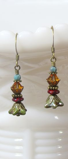 Earthy red, green, Topaz gold and blue rustic BEADED DANGLE EARRINGS, Bohemian Botanical floral and Boho inspired jewelry. Perfect pair of EARRINGS FOR EVERYDAY WEAR. Get your pair today at CharmedbyBonnie ARTISAN MADE JEWELRY