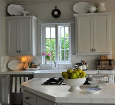 French kitchen design - like the  narrow double doors on the cabinets the best