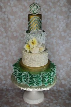 I made this cake for the SoFlo cake expo in Miami a few months ago. The bottom tier has petals, curved and accented with brush embroidery to look like waves. The next tier a a swirled pearl and shell pattern, the next tier has gum paste orchids...
