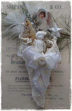Wonderfully filled vintage inspired white fabric Christmas cone!