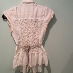Free People crochet back top Cute Free People crochet back top. Button down, lightweight, semi sheer. Belted waist. Cream colored, front pocket, XS. Measurements: armpit to armpit: 13.5 inches; length: shoulder to hem: 24.25 Free People Tops Button Down Shirts