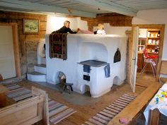 Traditional kachelofen-warmed bed in Czechoslovakia Cob House Plans, Stair Shelves, Cob Building, Stove Fireplace, Rocket Stoves, Earth Homes, Stone Houses, Interiores Design, My Dream Home