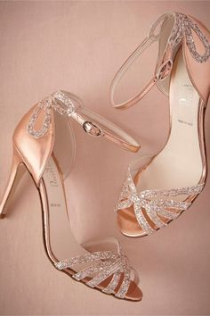 Gold bridal shoes with ankle straps and silver decor across the back of the heel and the multiple straps of these open toed high heels.