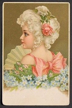 u-s-Clapsaddle-Beautiful-Blue-Eye-Girl-Pink-Rose-in-White-Hair-w-a-Fan-ca-1900