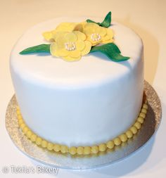 Wedding cake with yellow flowers. Carrote cake inside