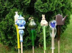 Garden art on a stick - inverted glass vase on a dowel stick with treasures glued to bottom...endless possibilities