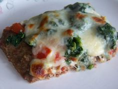 Spinach Tomato Meatza Pizza - Meat crust pizza referred to as Meatza. It's basically a seasoned ground beef mix cooked flat to make a crust then topped off with tomato sauce and cheese. You can add your favorite pizza toppings....
