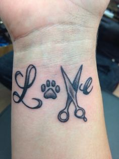 my brand new customized LOVE tattoo! Scissors for my hairdressing career, and paw print from my Vet tech career! <3