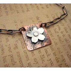 copper and silver flower pendant