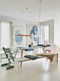 Modern dining area with similar spacial qualities being light and bright, yet still provides more traditional ways of using a dining area.