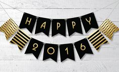 Celebrate New Year's Eve in a classy way with this free printable Happy 2016 banner in black and gold.
