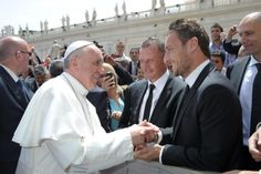 """Would you bring a jersey next time?"". Pope Francis meets AS Romas Totti during weekly audience at Vatican  Pope Francis meets AS Roma soccer player Francesco Totti during the popes weekly audience in St. Peters Square at the Vatican May 22. (CNS photo/ LOsservatore Romano via Reuters)"