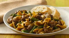 It's a success story with a very happy ending when ground beef, green beans and pasta meet up in your skillet, all simmered in a warm, perfectly seasoned sauce.