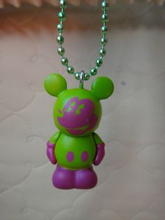 Disney Vinylmation Necklace- Green and Purple Mickey Mouse. I really want this for my Birthday!!!!!