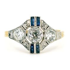 This classic deco ring feature (J Old Mine Cut Diamonds and Sapphires in Yellow & White Gold. Design Era: Art Deco Size: NL / FR / US / M½ UK, sizeable Weight in grams: Condition: Very good condition - slightly used with small signs of wear Ref: 2295 Diamond Sizes, Diamond Cuts, Gemstone Colors, Blue Yellow, 18k Gold, Bracelet Watch, Gold Rings, Vintage Jewelry, Handmade Items