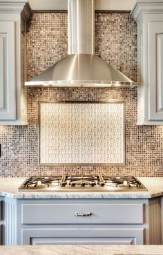 Chrome Stainless Steel Vent Hood: Painted Kitchen Cabinets: Mosaic Tile Back Splash: Gas Cooktop Stove  http://www.bickimerhomes.com/