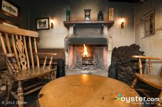 The quaint Bushmills Inn in Antrim is quintessentially Irish in every respect: There are fireplaces burning peat or wood throughout - Architecture Ireland, Irish Cottage, Cozy Cottage, Ireland Hotels, Farmhouse Fireplace, Rustic Farmhouse, Wood Burning Fires, Cozy Nook, Hotels And Resorts