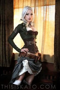 Steampunk Kato in a classic military bolero jacket, corset strapped with leather holster & lace drawn skirt.