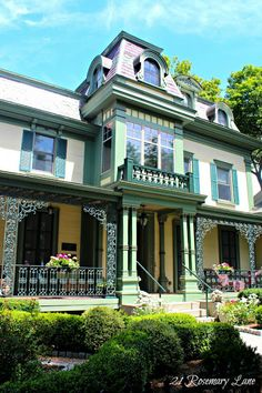 ~ {21 Rosemary Lane: The Fabulous Homes of Lake Skaneateles New York}....Simply <3 the porch's detailed iron front scroll work!