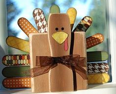 turkey made from paint stick, tongue depressors, and 2x4