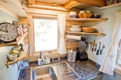 Corner space is usually underutilized in many homes. But when you're trying to make every square inch in your small kitchen count, corner shelving can give these awkward spots a purpose.- Tiny House Project